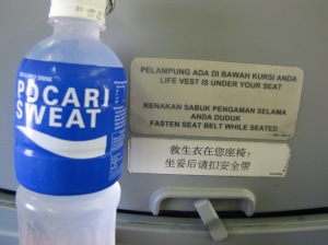 Pocari Sweat, the humorously named Indonesian (imported from Japan) drink is just the thing when you need to replace some electrolytes. Next to the bottle is the trilingual instructions on my plane from PP to Jakarta.