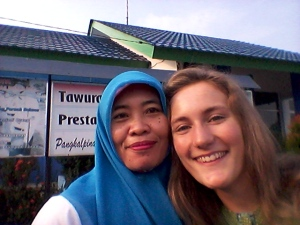 Ibu Isnaini (my co-teacher) and I in front of the school one morning last week.