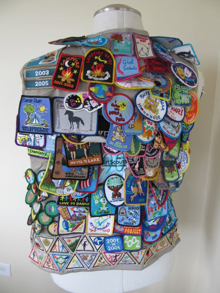 The back of my Cadette/Senior Girl Scout vest. Thanks mom for sharing this photo.