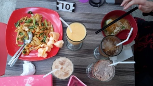 One person, one dish, two drinks. Livin' large in Indonesia.