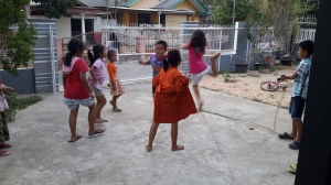 These are the kids of our immediate neighbors. Last week they wanted to hang out with us outside of our Thursday night English club, so we invited them in to play games in our yard. They played jump rope and a game like rock-paper-scissors, and we introduced them to the Limbo. They are our friends and, in a way, our protectors because they are always watching our house and accompanying us around the neighborhood. Their smiling faces and exuberant reception have made me feel welcome here.