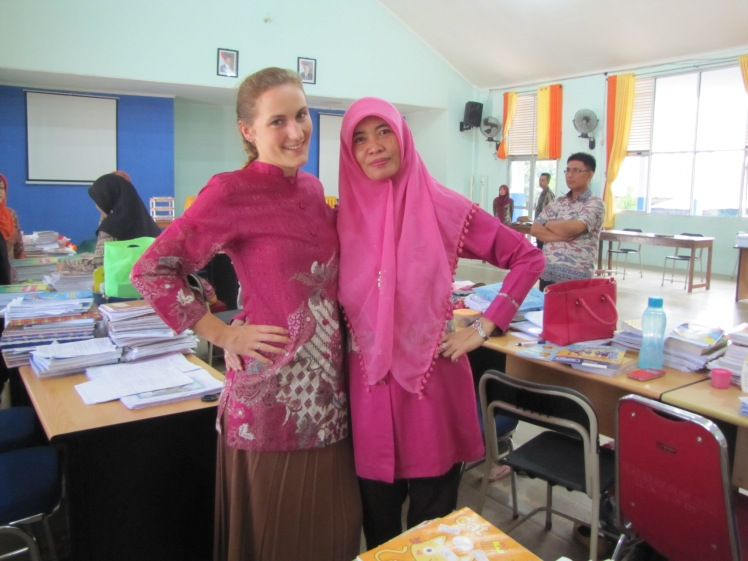 Me and Ibu Isnaini -- the ladies in pink. Our desks are of course next to each other in the teacher's office. And yes, we do often coordinate outfits. Despite the miscommunication that precipitated this post, we have a great personal relationship.