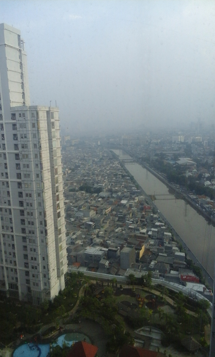 An unfiltered image of Jakarta from the window in the elevator bank of our apartment building. That is smog, not rain.