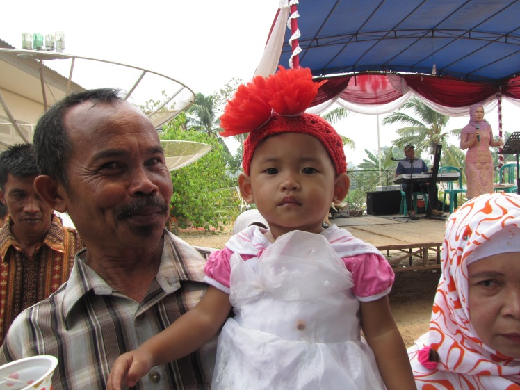 But I also get pictures of Indonesians too, like this cutie and her proud papa.