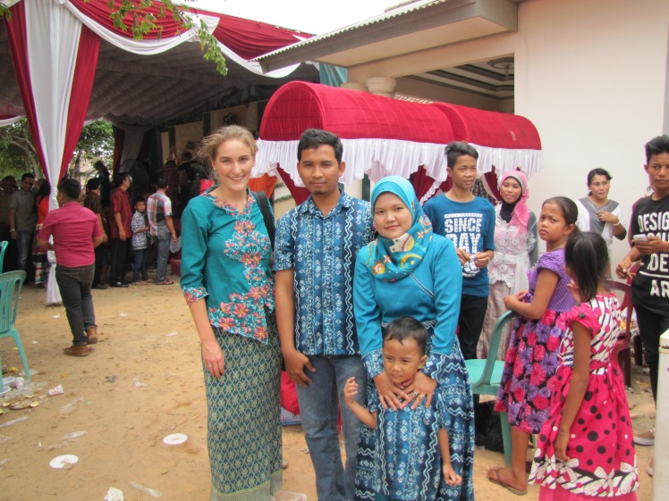 As I walked around taking pictures, I attracted quite a bit of attention. Everyone, from the hired help to families wearing matching batik, wanted to take photos with me. As a blonde-haired, blue-eyed foreigner here I am basically a walking photo-op.