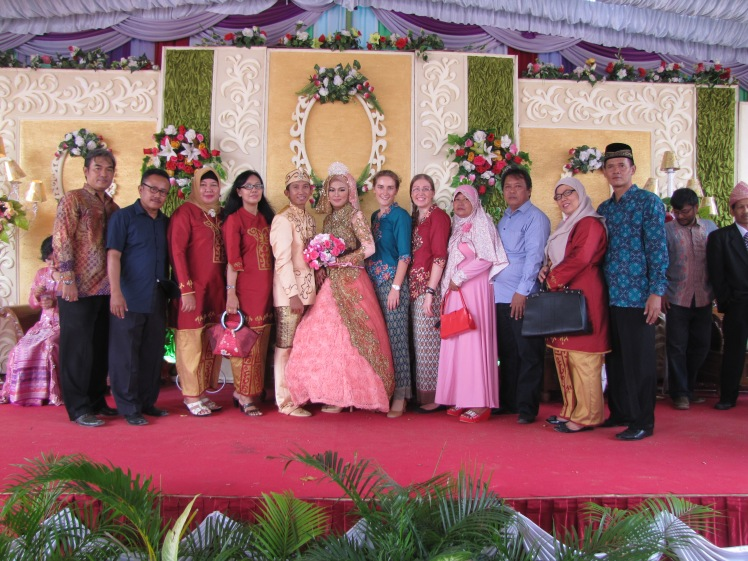 There is a break in the handshakers, and we make a break for it! The couple is in the center, with Caitlin and I and fellow teachers from SMK 2 (Caitlin's school) flanking out the sides.