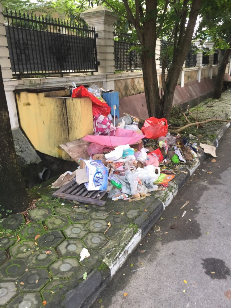 Garbage is still piled up around the city. It'll take weeks to clean up this mess.