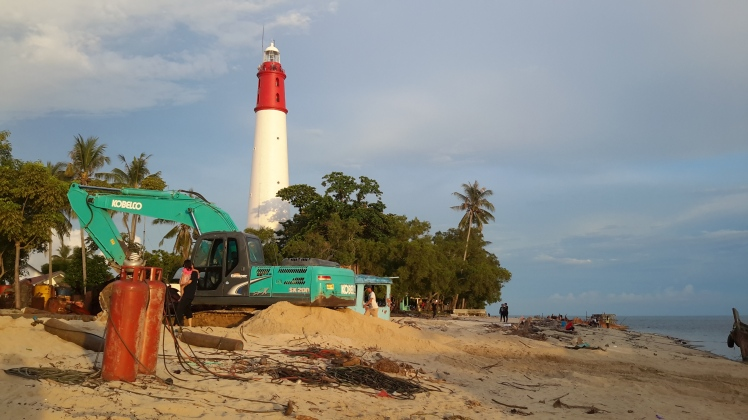 We came back to the lighthouse and the beach to watch the sunset. Some lovely construction equipment in the process of making who-knows-what is in the foreground.