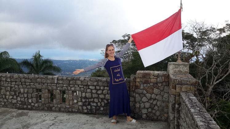 Another view, this time posing with the merah-putih (red and white, Indonesia's flag).