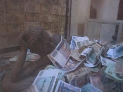 Buddha bathing in cash. Does anything seem strange here?