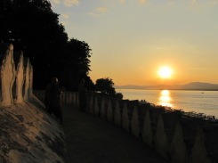 Sunset over the Irrawaddy River. Look closely in the shadows and you'll see one monk photographing his friend with a Samsung tablet.