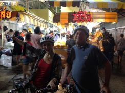 Dad and I riding our bikes through the evening flower market in old Bangkok.